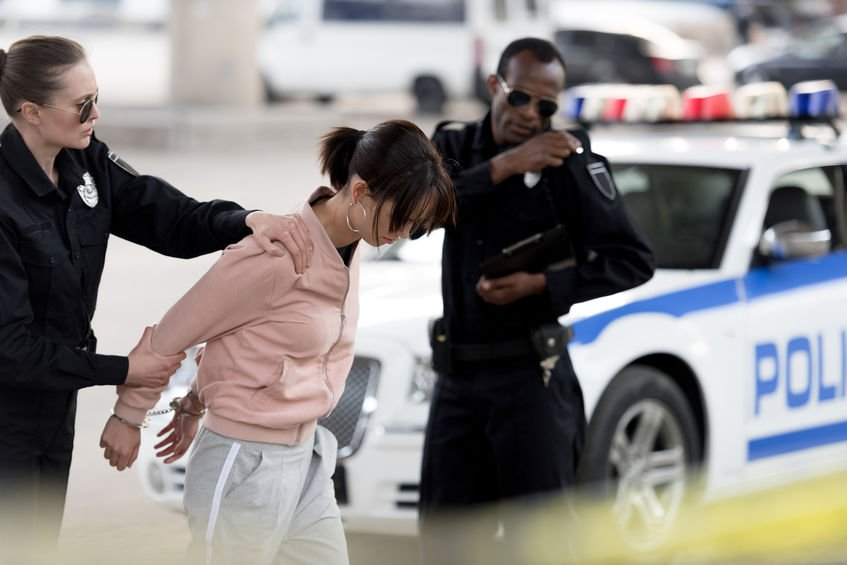 Woman being arrested