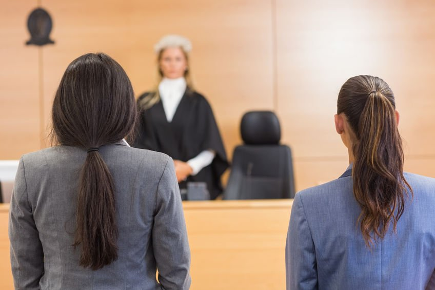 Lawyers listening to judge
